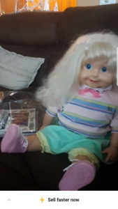 Vintage cricket doll with books and tapes  working