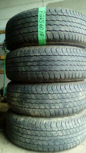 Four Bridgestone Duller 265 60 18 all season tires.