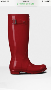 New shiny red hunter boots