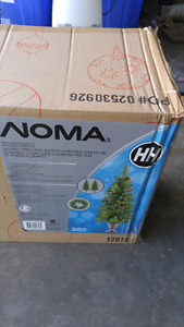 Noma lighted trees and wreath
