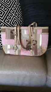 Coach Signature Fabric and Leather Handbag located in Kelowna