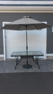 Mint condition tempered glass patio table and umbrella