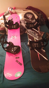 2 snowboards and boots