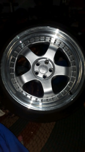 Very clean basically new wheels& tires 5x100 bolt pattern.