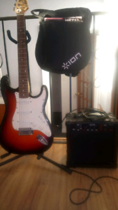 Ion guitar, amp, stand and carrying case