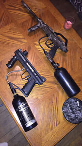 2 paintball guns with tanks