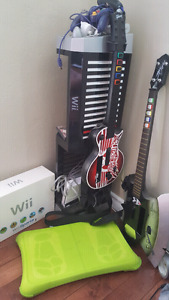 Wii with games, guitars, wii fit board and more!