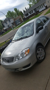 2004 Toyota Corolla - Standard with all 4 extra rims/tires