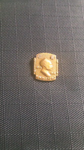 Gold Heinz pin with two diamonds