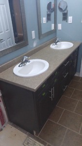 Bathroom vanity countertop with sinks and taps