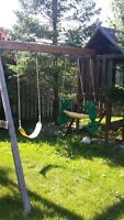 Wooden swing set / playhouse from Big Backyard