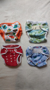 Four large diaper covers