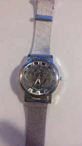 silver see through watch with metal straps