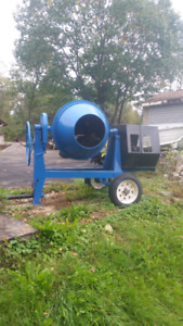 Cement mixer with plate tamper