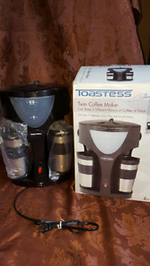 Dual coffee maker with travel mugs