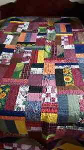 Beautiful homemade stippled patch quilt