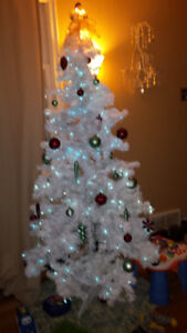 White Christmas Tree with Lights and Red and Green Decorations