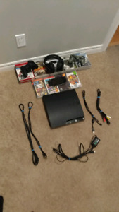 PS3 slim 250gb 20 games and 2 controllers