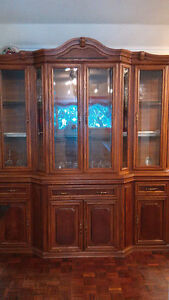 Solid Oak china cabinet with oak table and chairs.