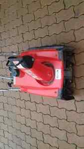 snow blowers and lawn mower