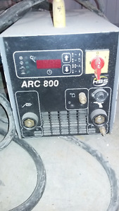Welders, cords, and helmets for sale