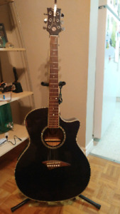 Acoustic guitar with guitar accessories