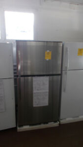 New 21 cubic foot stainless steel fridge. $899.