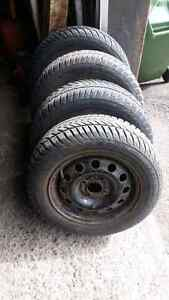 4x winter tires 185/65r14 and rims from 2002 ford focus 4x108
