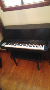 PIANO-Small Upright with Amp Jack-Handles in Back for Moving