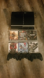 PS3 console with 6 Games