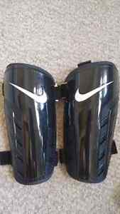 Boys soccer cleats and chin pads Kitchener / Waterloo Kitchener Area image 3