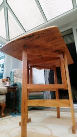 Vintage light wood drop leaf fold out table