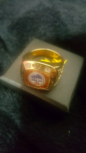 Gold ring with the name oilers