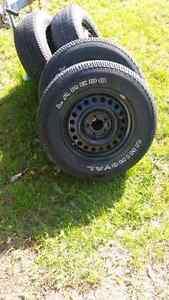 4 Uniroyal Laredo P225/60R16 Tires on 5 x 114.3 Steel Rims