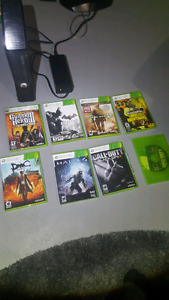 Xbox 360 with controller and working games.