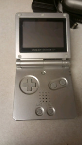 Silver Gameboy Advance SP, charger, case, original box, 10 games
