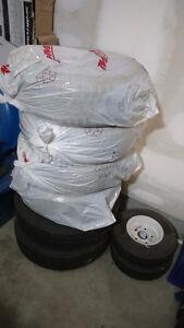 4 like new winter tires on 4 bolt rims. 185/65R15 London Ontario image 4