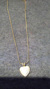 gold & silver necklaces with pendants. $3 each or 2 for $5.