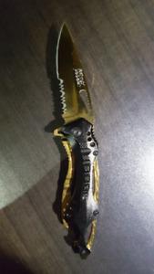 Pocket knife gold and black brand new