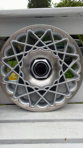 2 Chrysler hubcaps