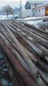 CLEARANCE, PRICED TO SELL,   40, - 15' to 20' LONG SOLID POSTS