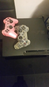 PS3 Slim W/ 2 Controllers