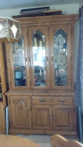 Good quality solid oak China cabinet and table