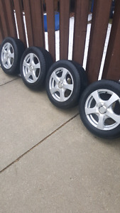 """Four 15"""" 5X114.3 or 5X100 rims with tires"""