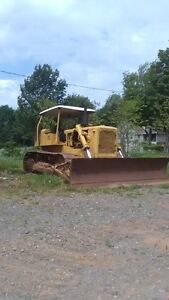 Cat D6-B Dozer with root rake for clearing land
