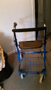Nearly new walker with seat