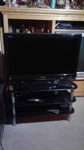LCD Aquos Sharp 32 inch TV with black glass stand
