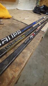 7 Bauer hockey sticks