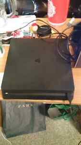 PS4 Slim with a controller and 2 games for sale