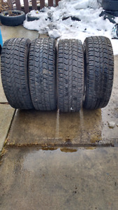 New 265/70/18R winter tires . Studded